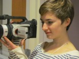 Sharon Kenney K'14 films outside the Index office. She is working on a documentary about the newspaper for her final project.