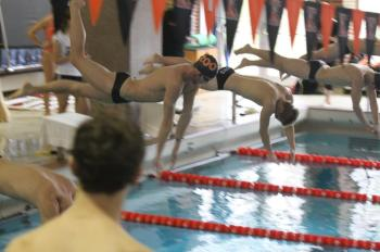 The men's swim and dive team during their victory over Alma last week end. Photo By Chuck Stull