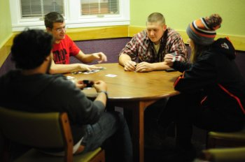 Ben Baker and friends play euchre on a Saturday night. Photo by Chandler Smith